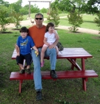 Allan Edwards (Janie's husband) and the grandkids on Good Friday.  Note:  I spent HOURS painting that picnic table red!